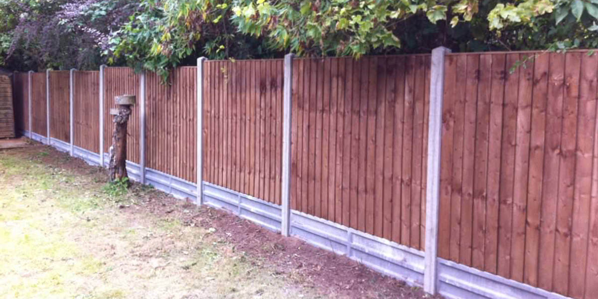 Concrete posts with featheredge panels