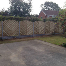 Vaga panels on concrete gravel boards and concrete posts